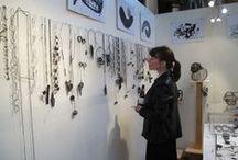 studio, display and artists at work