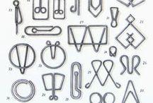 desk drawer / useful and frivolous, well-designed items for a designer's desk drawer: pens, pencils, staplers, paper clips, scissors, erasers, fasteners, felt pens, designer items, stylish