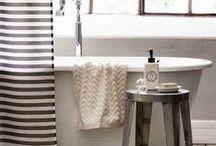 home: bath / beautiful bathroom design and elements: mirrors, bathtubs, sinks, toilets, soaps, hooks, towels, floors, rugs, baskets, shelves