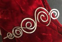 Beautiful handmade shawl pins, brooches and jewelry by Rivelin Arts / Handmade jewelry and pretty pins to dress up your shawls, scarves, woolly hats, knitted dress or jumper - #shawlpins #pins, #scarf clips, #shawl #brooches made from hammered aluminium, copper or sterling silver #wire.