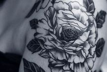 Ink / Beautiful tattoos, mostly botanical and mostly in black.