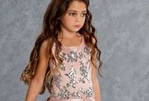 Biscotti Dresses / Biscotti's long standing tradition of offering amazing quality with all the bells and whistles in little girls designer clothes.  Beautiful special occasion dresses with hand beading, lush fabrics and a great fit.  From newborn to tween looks that will have her ready from church to any event.