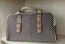 I love bags. Less is a bore / A woman can never have enough bags