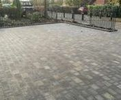 Shared Block Paved Driveway in Oxford / A shared driveway in Oxford measuring over 100 square metres with new Brett Trio block paving in Sliver Haze colour installed by the AWBS landscaping team