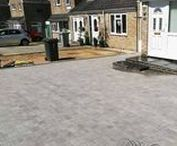 Silver Haze Block Paved Driveway / This customer in Oxford wanted to enlarge their drive and stop rain water flooding the garage. We installed new drains and Brett block paving.