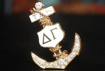 "DG Badges & Jewelry / Only initiated members wear our beloved golden anchor. In 1877, the original badge, in the shape of the letter ""H"" (standing for Hope) changed to an anchor, which is the traditional symbol for hope."