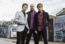 Muse / Matthew Bellamy + Dominic Howard + Chris Wolstenholme = The best band EVER!!! It is my goal in life to meet these guys :) / by Julia Smead