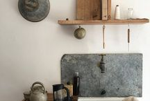 in the kitchen. / Inspiring kitchens for a future remodel in our country home.  - butcher block counters - subway tiles - polished concrete - white walls - vintage pottery