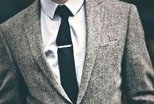 S1 Dress Code / Always a white shirt, and a dark tie or bowtie, or no tie, if you look hip/stylish enough that it isn't too casual. Otherwise, adding navy, tones of light grey and charcoal, tan, brown, and subtle patterns to the mix in the pants and blazers. Shoes brown or black preferably.