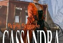 CASSANDRA, Bride Brigade 3 / Cassandra Bradford has the cast off wardrobe to pose as a lady. Her goal is to marry a wealthy man who can provide her young brother with a sound future. Drat the luck! The first man she sees in Tarnation is a dusty cowboy who sends her heart pounding. Not for her. She has a better life in mind. Bride Brigade book three.  A rich young widow imports some women to Tarnation, Texas for the men to chose for wives.  Inspirational, Victorian, western historical series, sweet, Texas
