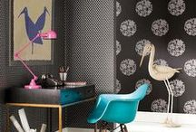 Temple & Webester / iscd / Eclectic black / turquoise and pink theme. Indulgent textured, black wallpapers with pops of pink or turquoise. Quirky artwork and ornaments and a touch of retro furniture.