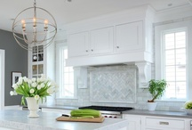 Kitchen Range Hood Ideas / Kitchen range hoods including chimney hoods, cabinetry hoods, wood hoods, tile hoods and plaster hoods frequently found in newly remodeled kitchens.