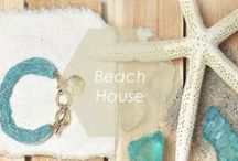 Beach House / Easy, breezy and reminiscent of vacation day delights, Foxy's laidback Beach House Collection is a mix of coastal-cool colors and geometric lines. Set a course for style, and make waves in your wardrobe with these shimmery accessories in our signature gold and silver metals.