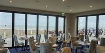 Brasserie on The Beach / Enjoy a new dining experience at our Brasserie on the Beach in Cooden, near Bexhill on Sea, East Sussex. After a transformation and extension, it opened on 3 February with a new menu On warm days it's glass walls will fold back so you can breathe in the fresh sea air. When summer hits you can also choose to eat outside on the Beach Terrace. Whatever the weather, the Gin Palace in the newly crafted Cafe Bar features eighteen artisan gins and a range of specialist tonics.