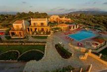 Enastron Villas / Enastron Villas, an unrivalled beauty in a splendid combination of mountain and sea, with incredible sunsets against the light blue of the Ionian Sea; one could name it an enchanting green vision built on a height with an exquisite view and a heavenly peace.