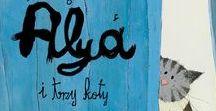 Alya i trzy koty / W biało – błekitnym domu w Casablance brzuch Miriam każdego dnia rosnie co raz większy … jak balon…! Trzy koty – Minusz, Pasza i Amir zaniepokojone zastanawiają się, jak zmieni się ich życie, kiedy na świecie pojawi się dziecko ? Historia nie tylko o kotach I o tym , jak zmienia się życie kiedy w domu pojawia się małe dziecko. Autor: Amina Hachimi Alayou   Ilustracje: Maya Fidawi
