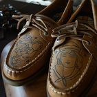 Sperry Ink / At Sperry we believe that the best stories are written with your feet, but sometimes these stories need to be written in ink. Throughout the year professional tattoo artists from around the country come to our stores to design tattoos on customers' shoes. To learn more about when these Sperry Ink events will be coming to your Sperry store visit Sperry.com and sign up for our email list