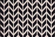 Chevron Rugs / A quick way to modernize and bring warmth to any room is to add a chevron rug. With several designs to choose from, you are sure to find a chevron area rug that will work with and enhance your current decor.