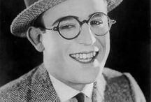 Harold Lloyd / One of the most popular and influential film comedians of the silent film era, Harold Clayton Lloyd made nearly 200 films between 1914 and 1947. His films frequently contained extended chase scenes and daredevil physical feats. Lloyd hanging from the hands of a clock high above the street in 'Safety Last!' (1923) is one of the most enduring images in all of cinema. Born: April 20, 1893, Burchard, NE Died: March 8, 1971 (age 77) Beverly Hills, CA Cause of Death - Prostate Cancer