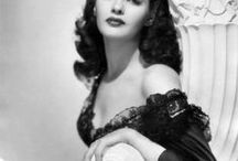 """Yvonne DeCarlo / Born Margaret Yvonne Middleton, Yvonne DeCarlo was a Canadian-American actress, dancer, and singer. A brunette with blue-gray eyes, she became an internationally famous Hollywood film star in the 1940s and 1950s, and later acted on television and stage. Best know for playing 'Lily Munster' on the T.V. hit """"The Munsters"""". Born- September 1, 1922 Vancouver, British Columbia, Canada Died - January 8, 2007 (aged 84) Los Angeles, CA Cause of death - Heart failure"""