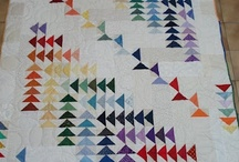 Flying Geese Quilt Pins / The Flying (or Wild) Geese pattern is a special case of the triangle family of quilt patterns. They are wider than tall unlike the half square triangles (HST)  in a triangle pattern quilt pattern. This is one of my favorite families. They convey freedom, wildness, distance to me. None of these are considered good social traits, but there you are . . . / by Elise Buhn