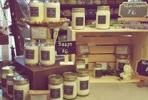 Mason Jar Candles / An assortment of soy wax candles. A variety of fragrances, sizes and colors. Even some of our products have made it on the board!