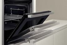 Neff Ovens / The iconic name of oven's Neff is a leading manufacturer in built-in house hold appliances. Renowned for their innovative technology especially built-in ovens know for the slide & hide door feature. But that's not all, the latest steam oven technology is set to become one of the next ways to cook in the home.