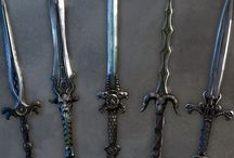 Fantasy Weapons + Armour / Below all the sections are pins I have added that give short definitions to all weapons except for the Staff as it is usually portrayed as a magical weapon and therefore I couldn't find much information. I used Wikipedia as my source for the information, but I did not copy word for word.