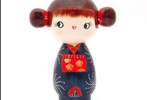 Kokeshi Collectables / Kokeshi (こけし kokeshi?), are Japanese dolls, originally from northern Japan. They are handmade from wood, have a simple trunk and an enlarged head with a few thin, painted lines to define the face. The body has a floral design painted in red, black, and sometimes yellow, and covered with a layer of wax. One characteristic of kokeshi dolls is their lack of arms or legs. The bottom is marked with the signature of the artist. #kokeshi #handicrafts #collectibles #Japanese #arts #crafts #dolls
