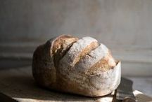 Bread \\ Baked goods / Freshly baked bread. Flour on the fingertips and a delicious aroma from the hot oven.