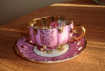 pretty cups and teapots,i used to collect them before i had children,i gave them all away,i could kick myself lol