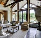 French-Country Style / French-country style custom living with large windows and butt glass that capture vast amounts of natural light that displays the architectural design throughout.   Corbell Custom Homes