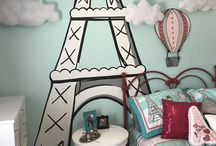 Paris Room / This is my daughters room. www.kidmuralsbydana.com designed and painted this entire room. Using the bedding from Target as her inspiration we painted a cartoon like Eiffel tower mural, added 3-D pillow like clouds and a custom painted wooden balloon. Paris room - girls room - kids murals - Paris mural - kids room decor - decor for kids - decor for girls - girls mural - Paris theme - Paris themes