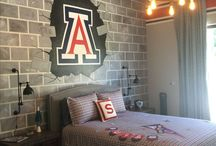 U of A Room / This boy was a huge fan of the University of Arizona so www.kidmuralsbydana.com of AZ created a room just for him! Although Dana is a huge fan of Arizona State University, She custom painted some blue and red stripes, used the UofA logo as the focus point, and made it bust through the faux painted brick wall. Boys room decor - sports mural - mural for boys - decor for boys - decor for kids - kids murals -   Sports room - kids room decor