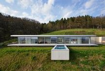 Villa K / Villa K, located in Thüringen, is the first German project for Paul de Ruiter Architects. The energy neutral villa, discrete and integrated in the natural environment adheres to minimalist principles. The result is a straightforward, innovative residence built from only glass, steel and concrete.