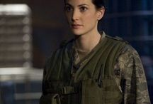 """stargate atlantis; cait. / major in the military, dating; john sheppard. """"there are monsters, and it's okay to be afraid of them. But it's not okay to let them win, and it's not okay to be one."""""""