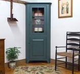 Corner Cabinets / Corner Cabinets are an elegant solution for small spaces. They are built in solid wood construction with adjustable shelves, finely finished inside & out and signed & dated by the cabinetmaker. Traditional joinery, doors are built with pegged mortise & tenon construction.