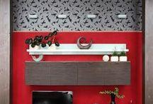 Wanddesign im Wohnzimmer / Die Audiovisuellen Unterhaltungsmedien nehmen im zeitgemäßen Leben eine zentrale Rolle ein. Man kann sie auch geschickt in eine gestaltete Medienwand integrieren