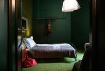 Stay in style in Krakow ! / stylish boutique apartment design - dark green interior with the grass on the wall !