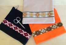 Spitak Bags / This wonderful collection of bags and cases made by the Spitak Women's Resource Center use handcrafted carpet and knitted elements, and are of very high design and quality.  Their newest pomegranate and petroglyph series' have really caught on!