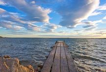 Long walk off a short dock / The best spot to dip your toes in and daydream on the reflection of the world around you!  #Sittingonthedock #Dock #Pier #Pond #Ocean #River #Waves #Outdoors #Outside #Nature #Water #Blue #Sky #Clouds #Rocks #Shore #Boats #Swim #Sit #Reflect #Reflection #Breathe #makesmewander