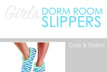 Girls Dorm Room Slippers / DormCo's Girls' Dorm Slipper Snoozies provide the perfect dorm items for keeping feet snuggly and comfy. Neither slippers nor socks, Snoozies are dorm supplies that are stylish, fun, warm, and are dorm essentials! You may have a dorm rug by your bed so you don't have to step on cold, hard dorm floor in the morning when you wake up, but beyond your dorm rug is super cold dorm flooring.