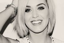 Katy Perry (Music) / Katheryn Elizabeth Hudson, known professionally as Katy Perry, is an American singer and songwriter. After singing in church during her childhood, she pursued a career in gospel music as a teenager.