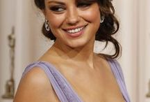 """Mila Kunis / Milena Markovna """"Mila"""" Kunis is an American actress. In 1991, at the age of seven, she moved from Soviet Ukraine to Los Angeles with her family. After being enrolled in acting classes as an after-school activity, she was soon discovered by an agent."""