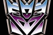 Transformers (G1): Decepticons / The Decepticons are a faction of sentient mechanical self-configuring modular robotic lifeforms from the planet Cybertron led by Megatron & are the primary antagonists in the 'Transformers' universe. Notably, Decepticons have red eyes & are typically represented by the purple facial insignia they all wear. Primarily, they have a preference for the high-tech & powerful vehicles, such as military aircraft & equipment & construction vehicles for their earthly disguises.