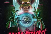 Mars Attacks: Ack, Ack, Aaack!! / Mars Attacks! is a 1996 comic science fiction horror film directed by Tim Burton based on the cult trading card series. The film cast includes Jack Nicholson, Glenn Close, Annette Bening, Pierce Brosnan, Danny DeVito, Martin Short, Sarah Jessica Parker, Michael J. Fox, Rod Steiger, Tom Jones, Lukas Haas, Natalie Portman, Jim Brown, Lisa Marie Smith, and Sylvia Sidney. The film is a parody of science fiction B movies and includes elements of black comedy and political satire.