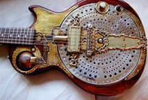 Guitar Ideas / I never thought I would find so many guitar related things on Pinterest.  There are so many different cool steampunk and elaborately decorated guitars it's not funny.  There's also some great pictures of guitarists, and even some guitar home decor and furniture.