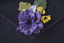 DAISY BAGS / Designed by Shou Shou Crafts... Felt and Leather flowers used on our Daisy clutches......