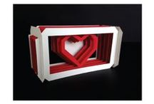 """Creative DIY Valentine's Day Cards / A collection of do-it-yourself pop-up Valentine's Day cards. What you'll need: X-Acto, not scissors. You're better than that; Bone Folder; Straight edge or metal cork backed ruler; Cutting mat or friend's table; Printer; 8.5"""" by 11"""" cardstock paper (80lb-100lb); Someone special to think about the whole time (optional)"""