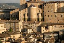 Le Marche Hilltop Towns / Tiny mediaeval towns, towering on hilltops, clinging to cliffs, looking down on the plains below.  Winding streets, honey-coloured stone, flowers spilling from windows and doors. Village squares, coffee bars, friends taking time to chat.  Welcome to Le Marche's hilltop towns.